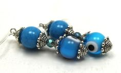 9 mm aqua blue Evil Eyes, 10mm dyed blue jade, iridescent crystals and Bali silver dangle earrings