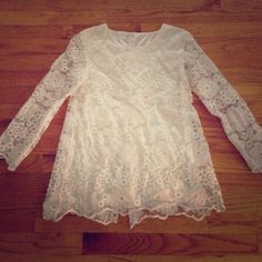 NWOT Ivory Lace Top Size S - M New without tag. Ivory lace with silk lining. No size tag, fit size Small - Medium. Tops