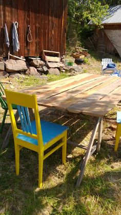 Self-made table and old yellow-blue chair at our fishing farm