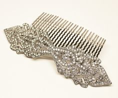 Vintage inspired rhinestone bridal hair comb features high quality rhinestones set in a silver setting in a timeless art deco vintage design. This beautiful wedding headpiece is perfect for the timeless, elegant bride.