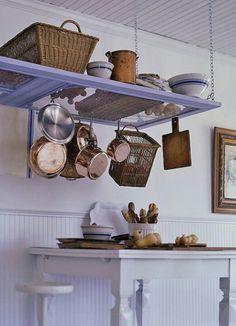 Repurposed screen door - kitchen storage.