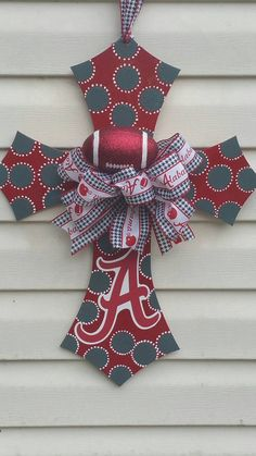 Alabama Crimson tide wooden cross painted by LilysFlowersGifts Alabama Door Hanger, Alabama Decor, Alabama Crafts, Alabama Wreaths, Alabama Football Wreath, Cross Door Hangers, Wooden Door Hangers, Crimson Tide Football, Alabama Crimson Tide