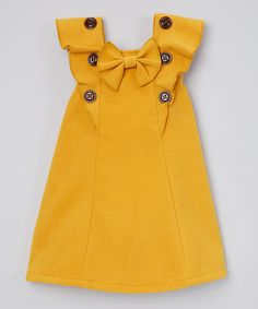 Sweet Charlotte Yellow Ruffle Top - Toddler & Girls by Sweet CharlotteDarling Details ❤~ buttons, bow and ruffles. something special every dayButton-adorned ruffles and a bow accent lend carefree flair to this breezy top crafted from breathable fab Baby Outfits, Toddler Outfits, Kids Outfits, Toddler Girl Style, Toddler Dress, Toddler Girls, Little Girl Fashion, Kids Fashion, Fashion Wear