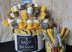 A baby is brewing party sampler with Rice Krispy pops, Oreo Pops, and Marshmallow Pops