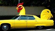 Do you like my new ride?  Since I live in the Poultry Capital of the World, I thought it was fitting.  Plus, I will never again have a hard time finding my car in a crowded lot.  giggles - Seriously, I would love to meet the owner of this car.  He/She has a great sense of humor.  :)