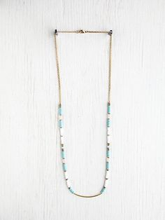 Turquoise Beaded Necklace--So simple with those gold tubes.