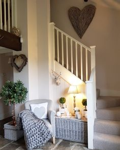 Is it really summer ! Does not feel like it... need to stay cosy.. Hallway Stone floor Extra large wicker wall heart  Grey trunks Stags head