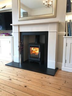 Wood Burning Stove Installation in London - Install My Fireplace Wood Stove Hearth, Wood Burner Fireplace, Home Fireplace, Living Room With Fireplace, Fireplace Surrounds, Fireplace Ideas, London Living Room, Living Room Lounge, Home Living Room