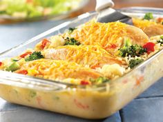 Cheesy Chicken Rice Casserole - This one-dish wonder features moist, tender chicken breasts covered with melted Cheddar cheese, sitting on a bed of creamy rice and vegetables - it just doesnt get any(Favorite Pins Chicken Casserole) Cheesy Chicken Rice Casserole, Cheesey Chicken, Veggie Casserole, Baked Chicken, Bean Casserole, Broccoli Casserole, Boneless Chicken, Healthy Chicken, Veggie Bake