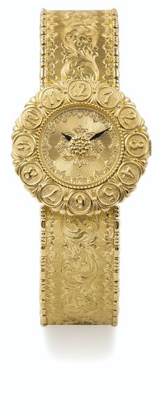BUCCELLATI A LADY'S YELLOW GOLD BRACELET WATCH CASE 0022 ELIOCHRON CIRCA 2008 • quartz movement • engraved dial • 18k yellow gold case, flower-shaped bezel with engraved Arabic numerals, engraved flower to the centre of the dial • 18k yellow gold ingrated www.thesterlingsi...