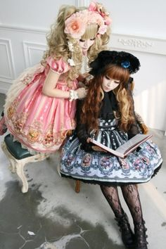 Reading together. a hime lolita with an elegant lolita