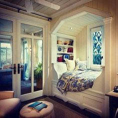 Get super cosy with a duvet in your nook. | 19 Cosy And Covetable Reading Nooks Love most of these, but i especially love the idea of a cozy little book nook with natural light! (Stain glass would be beautiful right there too)