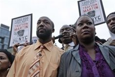 Trayvon Martin's parents Tracy Martin, left, and Sybrina Fulton, right, take part in the Million Hoodie March in Union Square Wednesday, March 21, 2012 in New York. [AP Photo]