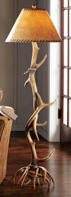 Cabela's Six-Antler Floor Lamp Poly-resin antler base and pole intertwine for a unique, wild appeal Parchment shade with faux-leather trim adds a rustic look Perfect for any home or cabin #TableLamp