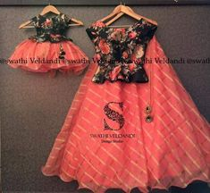 Kids frocks design - Lovely mom and daughter duo Beautiful orange color lehenga and black color top with floral print 23 September 2017 Mommy Daughter Dresses, Mother Daughter Matching Outfits, Mother Daughter Fashion, Girls Frock Design, Baby Dress Design, Kids Dress Wear, Kids Gown, Baby Frocks Designs, Kids Frocks Design