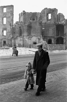 Father and son take a walk in postwar Warsaw, Poland, 1957. The destruction of the city following repeated rounds of heavy fighting are still very visible. Warsaw fully recovered by the 1970s.