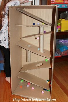 Cardboard box marble & pom pom ramp. This was so much fun & a great activity for kids - arts & crafts from recyclables