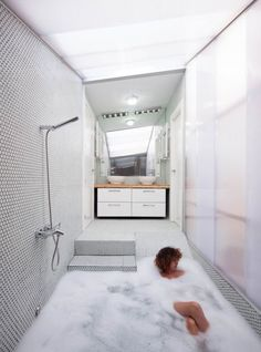 I really like how the bath tub is more like a walk/slide in! Love this for small master bathroom;)