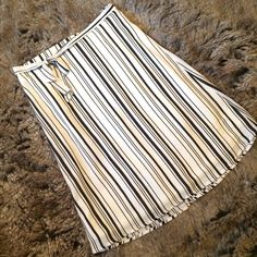 """Black and white stripe skirt Super cute black and white vertically striped skirt. Tie around waist, elastic in the back of the waist band. S-M-L sizes available. S=L:23"""", W:12.5"""", M=L:24"""", W:14.5"""", L=L:25"""", W:16"""". Has stretch. Brand new, no tags. Please ask me to make you a separate listing to purchase. DO NOT PURCHASE THIS LISTING. Charlotte Russe Skirts"""