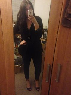 All black - sweater, blazer, jeans and ankle straps