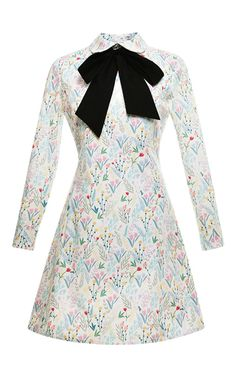 Crafted in floral printed cotton poplin, this long sleeved **Vivetta** dress features a rounded collar with a contrasting tied bow at the neck and an A-line skirt.