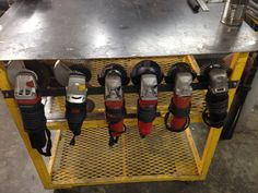"""Grinder Rack by jniolon -- one more.... rack for holding 4.5"""" grinders on my welding table..."""