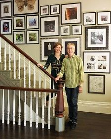 One family works together to artfully arrange a two-floor arrangement of family pictures. Learn tips and techniques to create your own wall that talks.