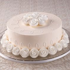 Classic Ribbon Roses are lovely as a border and as a cake top bouquet on this elegant ivory cake.