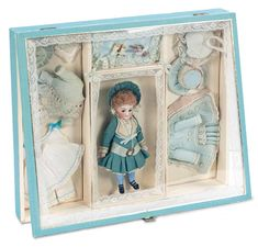 antique doll's presentation box | Lot: 188. German All-Bisque Doll in Presentation Box with Trousseau