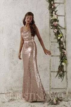 This full-length sequined gown is accompanied by an attached satin waistband and topped by a cowl neckline, held by dainty spaghetti straps. #bridesmaids