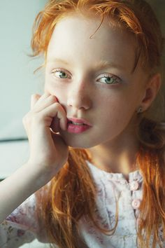 She is going to break so many hearts as she gets older.  Beautiful eyes, incredible hair.  She truly will be glorious.