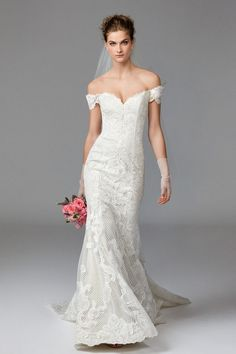 Watters Alma wedding dress -- Alma is classic romance with a modern twist. Baroque Lace is thoughtfully-placed on top of Lattice Lace to flatter and contour the body. Its off-the-shoulder neckline is highly-trending in both ready-to-wear and bridal fashion, keeping her at the forefront of style. Chapel Train.