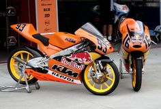 The Red Bull KTM Moto Sport 125cc machines of #16 Cameron Beaubier and #93 Marc Marquez sit in the pitlane at IMS during the Red Bull MotoGP Indy round in August of 2009