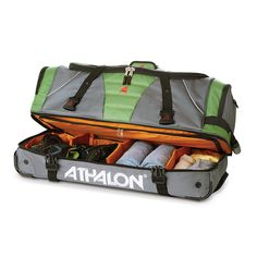 4813570a34da Maximum checked bag size. Over under section separates shoes from clothing.  High-density Athalon sport cloth with a heavy-duty water-resistant backing  has ...