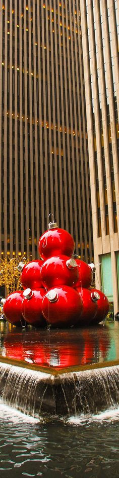 Giant red ornaments at 1251 Sixth Avenue, near Rockefeller Plaza in midtown Manhattan, New York City at Christmas. Top 10 things to do in NYC in December, what to do in NYC at Christmas or New Year Holidays
