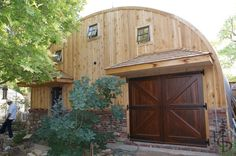 quonset hut houses   Quonset hut with nicely finished ends and custom carriage doors and ...