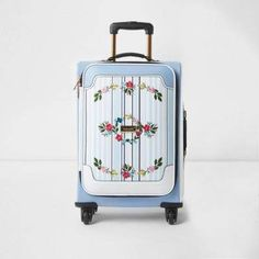 Faux leather fabric outer Stripe print front Floral embroidery RI branding Gold tone hardware Pull up handle Top and side handles Four wheels Zip around fastening Height width depth volume (L) 36 Floral Stripe, Stripe Print, Cute Suitcases, Faux Leather Fabric, Carry On Luggage, Travel Accessories, Floral Embroidery, New Outfits, Blue Stripes