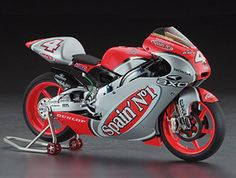 Hasegawa 1:12 Honda NSR250 Plastic Model Motorcycle Kit HS21706 This Honda NSR250 Team Spain Gresini (2002) Plastic Model Motorcycle Kit comprises 166 pieces. This model kit made by Hasegawa requires assembly and is 1:12 scale (approx. 17cm / 6.7in long).    Team Gresini has run a lot of very close races to little reward, but in 2002 racer Roberto Rolfo put the team on the podium with a third place finish in the 250cc class. His motorcycle, the Honda NSR250 has raced to world championship…