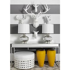 Decorating with Antlers and Animal Heads - we love those animal heads from ZGallerie!