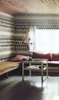 Wow this wallpaper! Heart has stopped.  I'm thinking kitchen with wood open shelving and all black dishware.