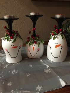 Adorable snowman wine glass candle holder, set of 3, will make a beautiful addition to your Christmas decorations! Each of these painted wine glasses has a cute snowman face and is adorned with sparkley greenery and red and white berries. Display these wine glass candle holders on your mantle, table or even in your window! Each snowman comes with a lightly scented, red tea light candle. This set of 3 snowmen is ready to be shipped out the next day after order is placed.  These wine glasses…