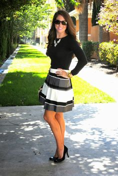This striped skirt is the perfect mix of glam and classic. Wear it with a fitted black sweater and statement necklace for a fall wedding.