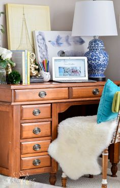 Blue and white ginger jar lamp in a global desk vignette via Casa Watkins