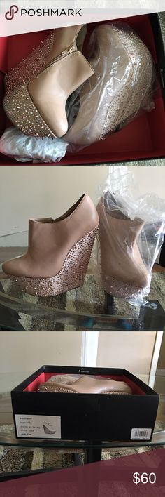 Wild Pair Nude Blush Platform Bootie Nude Platform Blush Spiked Heel Bootie... Only worn Once. These are no longer available in the stores. They have beautiful spiked detail on the bottom of the shoe. Size 7 1/2. Wild Pair Shoes Ankle Boots & Booties