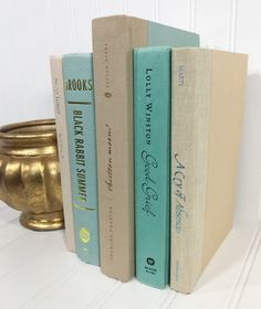 Teal and Tan Book Set by ElementsByAmber on Etsy. Decorative Books. Check out vintage items to decorate shelves and mantels. Shelf Decor. Mantel Decor. Decorating shelves. Decorating Mantel.
