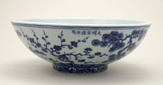 Porcelain bowl with the Three Friends of Winter (pines, prunus and bamboo) in underglaze blue. Horizontal inscription below the rim.