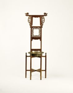 """Washstand China, 1550-1620 The Victoria & Albert Museum """"Towel rails and washbasin stands were integral components of the bedroom furnishings of the wealthy upper classes in China, for whom washing was a daily habit. Ming illustrations show that a brass basin was placed on the stand and filled with water for washing and the towels were hung on the towel rack after use and possibly between uses. Basin holders and towel racks were made both as individual pieces of furniture as well as in ..."""