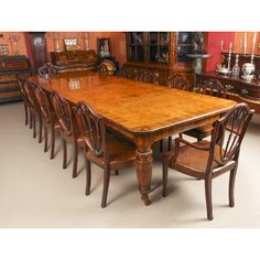 An exquisite dining set comprising a rare English antique Victorian pollard oak extending dining table and a set of 12 antique dining chairs. Victorian Dining Tables, Buy Dining Table, Oak Extending Dining Table, Antique Dining Chairs, Extendable Dining Table, Dining Set, Table And Chair Sets, Side Chairs, Industrial Revolution