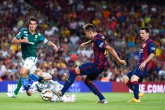 Munir of FC Barcelona scores his team's fourth goal during the Joan Gamper Trophy match between FC Barcelona and Club Leon at Camp Nou on August 18, 2014 in Barcelona, Catalonia.