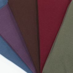 Jewel Half Yard Lot Solid Cotton Ribbed Knit Fabric - 5 different colors in baby cotton ribbed knit precut into half yard size pieces.  You get all 5 colors shown in the lot and they are all jewel colors of grass green, maroon, brown, purple, and blue.  Baby cotton ribbed knit has a fine wale rib, soft hand, and good stretch.  Great for use as necklines, sleeve bands, waist bands, and also for ribbed tank tops, baby wear, and much more!  ::  $15.00